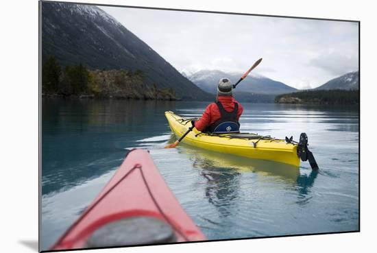 Young Woman Kayaking on Chilko Lake in British Columbia, Canada-Justin Bailie-Mounted Photographic Print