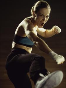 Young Woman Kickboxing