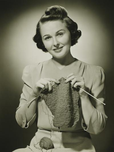 Young Woman Knitting in Studio, Portrait-George Marks-Photographic Print