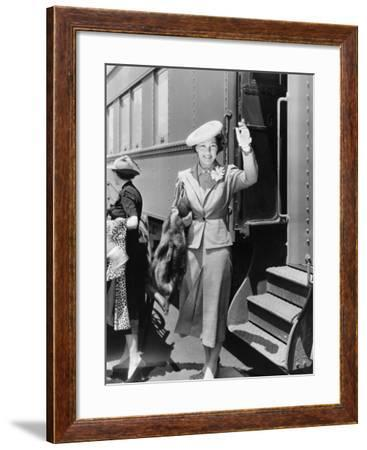 Young Woman Next to Train Waving--Framed Photo