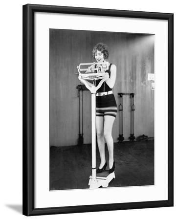 Young Woman on a Scale Taking Her Weight--Framed Photo