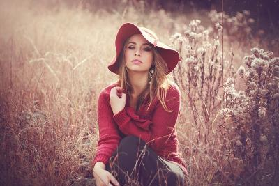 Young Woman Outdoors Wearing a Red Hat-Sabine Rosch-Photographic Print