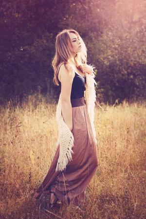 https://imgc.artprintimages.com/img/print/young-woman-outdoors-wearing-a-shawl_u-l-pz0t2t0.jpg?p=0