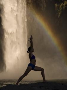 Young Woman Practicing Yoga on a Rock, Snoqualmie Falls, Washington State, USA