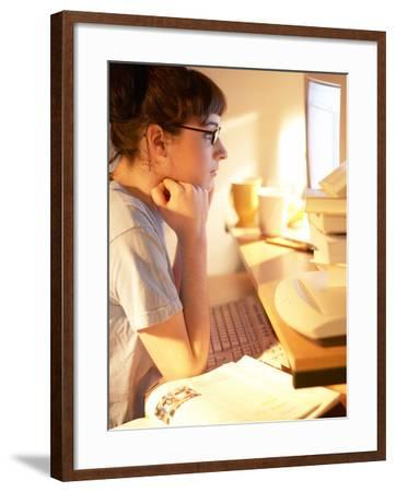 Young Woman Reading from Her Desktop Computer Screen and Studying--Framed Photographic Print