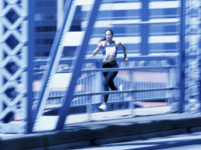 Young Woman Running--Photographic Print