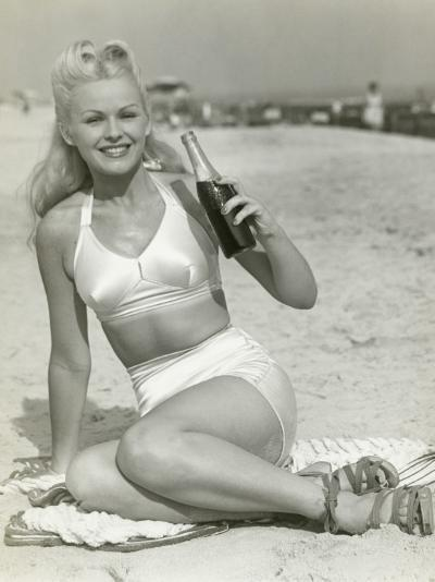 Young Woman Sitting on Beach With Soft Drink, Portrait-George Marks-Photographic Print