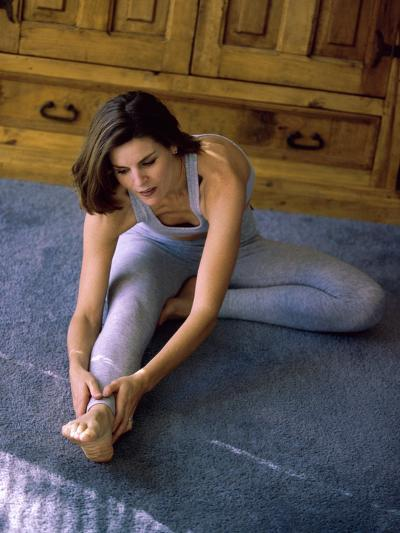 Young Woman Stretching on the Floor--Photographic Print
