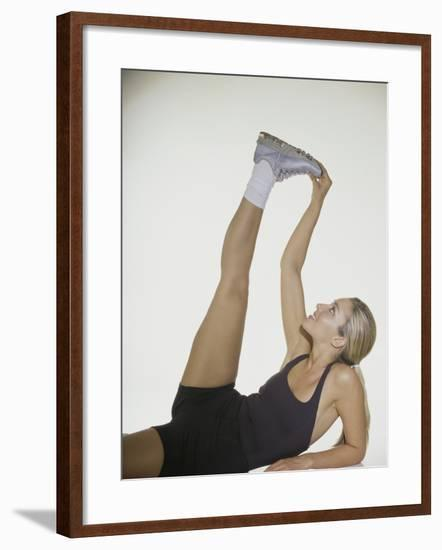 Young Woman Stretching--Framed Photographic Print