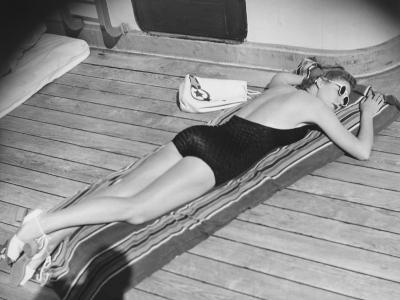 Young Woman Sun Tanning on Cruiser Deck-George Marks-Photographic Print