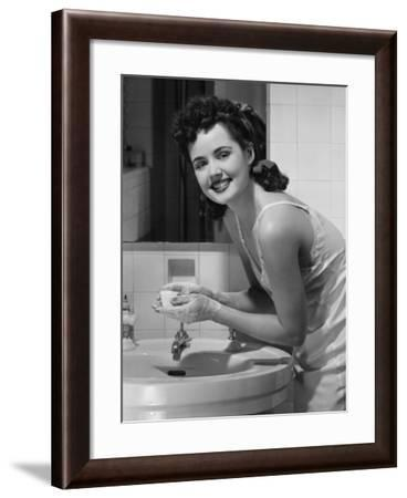 Young Woman Washing Hands in Bathroom, Portrait-George Marks-Framed Photographic Print
