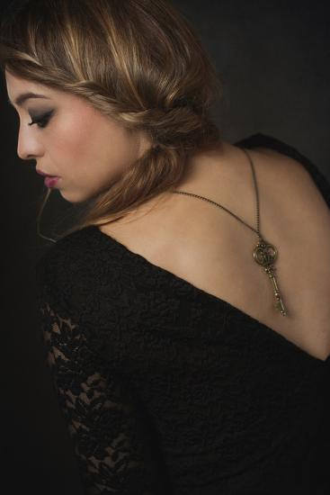Young Woman Wearing Black Dress with Key on Necklace-Sabine Rosch-Photographic Print