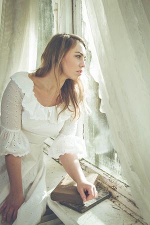 https://imgc.artprintimages.com/img/print/young-woman-wearing-white-dress_u-l-pz0s0i0.jpg?p=0
