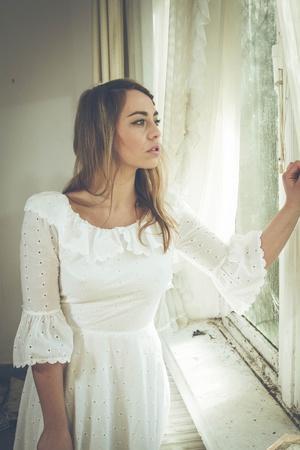 https://imgc.artprintimages.com/img/print/young-woman-wearing-white-dress_u-l-pz0s4c0.jpg?p=0