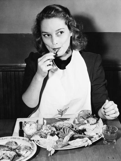 Young Woman with a Bib Eating Lobster--Photo