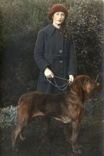 Young Woman with a Dog in a Garden--Photographic Print