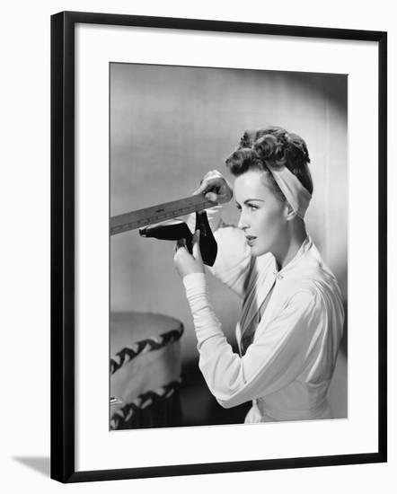 Young Woman with a Ruler Measuring Her Shoe--Framed Photo