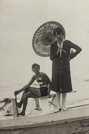 Young Woman with Umbrella and Boy on Pedal Boats on the Beach of Forte Dei Marmi--Photographic Print