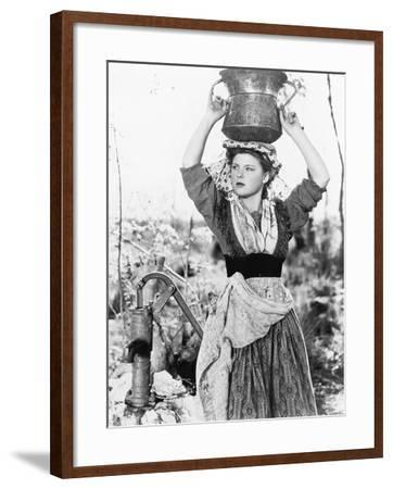 Young Woman with Water Bucket on Her Head Next to a Well--Framed Photo