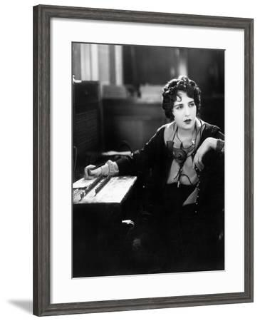 Young Woman Working as a Telephone Operator--Framed Photo