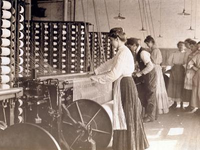 Young Women Working at a Spinning Machine in a Cotton Mill, South Carolina, 1908-Lewis Wickes Hine-Photographic Print