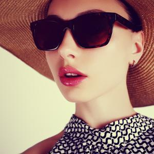Beautiful Sensual Young Brunette Woman in a Hat and Sunglasses by Yuliya Yafimik