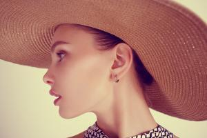 Portrait of a Beautiful Sensual Young Brunette Woman in a Hat by Yuliya Yafimik