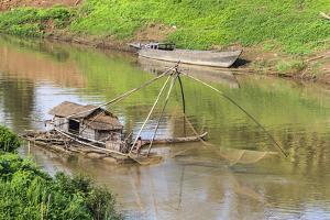 Kratie, Cambodia. Floating Vietnamese houseboat on the Mekong River in Kratie, Cambodia. by Yvette Cardozo