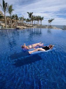 Women in Pool, Cabo San Lucas, Baja CA, Mexico by Yvette Cardozo