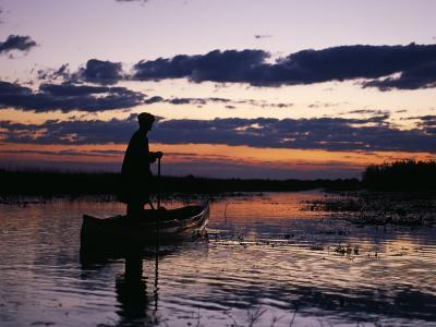 Zambia Game Scout Poling Mokorro Along Lukulu River at Sunset-John Warburton-lee-Photographic Print