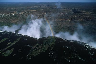 Zambia, Mosi-Oa-Tunya National Park, Rainbow over Victoria Falls--Photographic Print