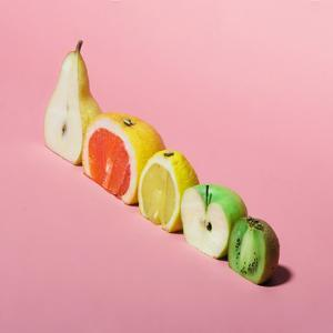 Various Fruits Sliced in Half. Minimal Concpet. by Zamurovic Photography