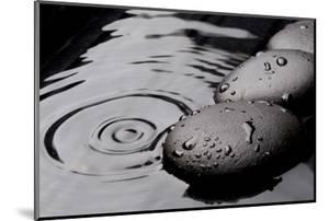Zen Stones on Wet Black Background